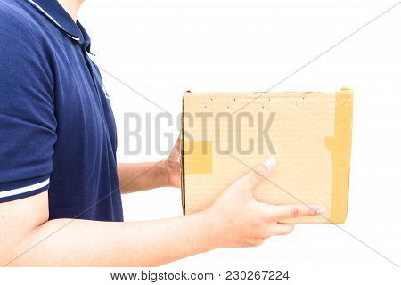 Delivery Man In Blue Uniform Holding The Box Isolated On White Background