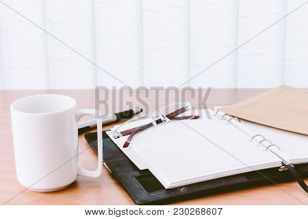 Workplace In Office On A Wooden Table
