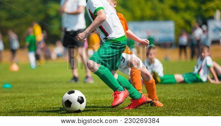 Boy Dribbling Football. Football Game For Children. Training And Football Soccer School Tournament.