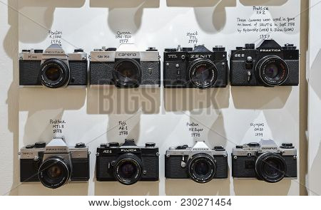 London, Uk - Mar 6, 2018: Vintage Film Cameras Lined Up On Wall In Chronological Order I Late 1970s