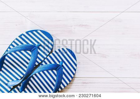 Beach Flip-flops On A White Wooden Background