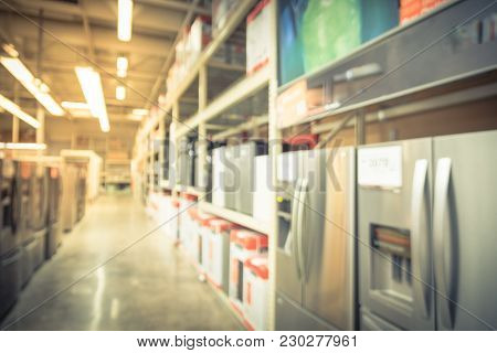 Blurred Row Of Mini Fridges At Retail Store In America