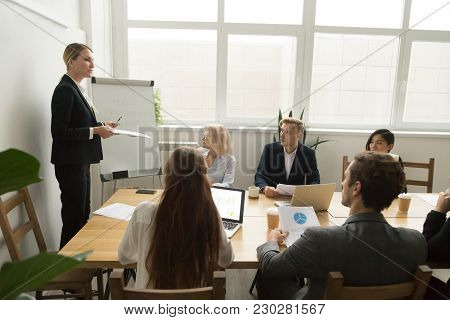 Female Team Leader Or Businesswoman Ceo In Suit Presenting New Project Discussing Corporate Plan At