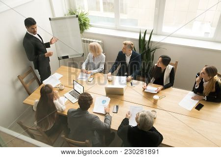 African American Ceo Boss In Suit Giving Presentation At Corporate Team Meeting Concept, Diverse Exe
