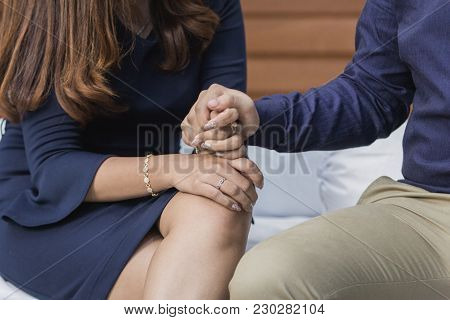 Close Up Of Young Asian Couple Holding Hand Each Others. Sharing Concept