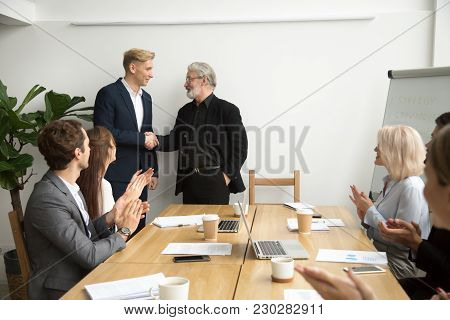 Senior Gray-haired Businessman Boss Promoting Male Employee Thanking Appreciating Good Work Shaking