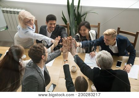 Diverse Motivated Multi-ethnic Business Team Giving High Five Showing Unity Concept, Young And Old C