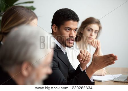 Serious African American Ceo Giving Instructions At Diverse Team Meeting, Confident Black Leader Tal