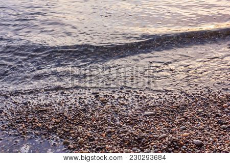 Close Up View Of Tide On Pebble Beach