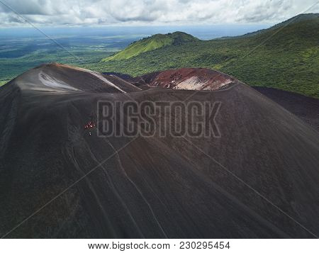 People On Cerro Negro Volcano Crater Sliding On Board Activity Aerial View