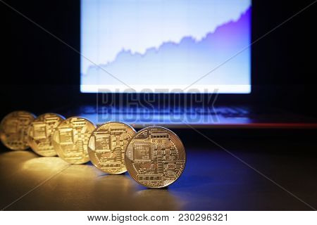 Trends And Novelties In The Ico Market. A Magnifying Glass, Gold Coins Of Electronic Currency And A