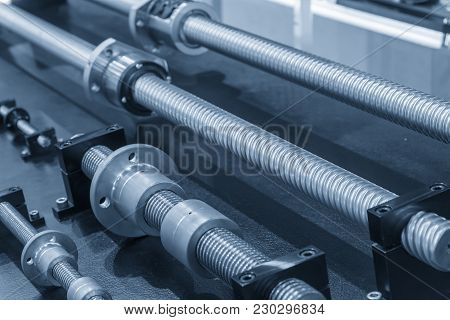 The Lead Screw Spare  Part Of Cnc Machine In The Light Blue Scene.