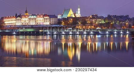 Panorama Of The Old Town With Reflection In The Vistula River During Evening Blue Hour, Warsaw, Pola
