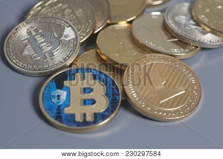 Litecoin, Ethereum Altcoin And Bitcoins Cryptocurrency Coins On A Gray Background