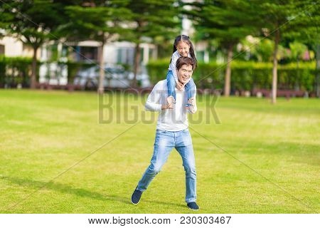 Cute Asian Girl On Neck Dad Big Happy Laughing And Run Around Together.happy Man Piggybacking Adorab