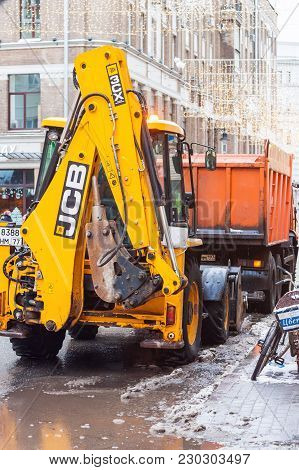 Moscow, Russia - December 24, 2017. Municipal Cleaners Remove Snow With A Garbage Truck