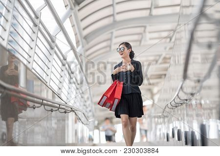 Attractive And Exusive Business Woman Wearing Modern Sunglass With Lot Of Red Shopping Bags. Happy A