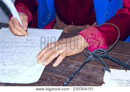 Hands Of Clerk Writing Old Letter. Wax Figure Of Old Clerk In Museum Of Baturin. Old Ukrainian Clerk