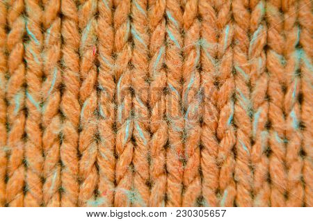 Orange Knit Texture Close-Up. Knit Sweater Blank Background
