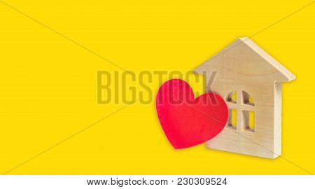 House with a heart. House of lovers. Affordable housing for young families. Accommodation for lovers of couples. Valentine's day house. Young family love real estate. banner, space for text