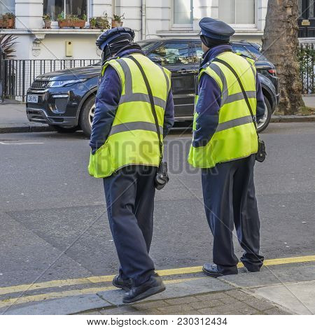 London, Uk - March 8, 2018: Two Highways Agency Traffic Officers, Their Purpose Is To Write Tickets