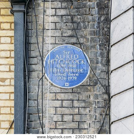 London, Uk - March 8, 2018: English Heritage Blue Plague Of Where The Famous Film Director, Sir Alfr