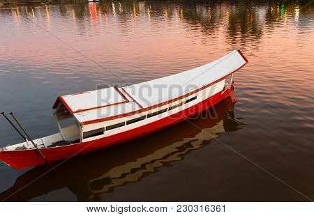 Traditional Wooden Boat On The Sarawak River, Kuching, Malaysia.