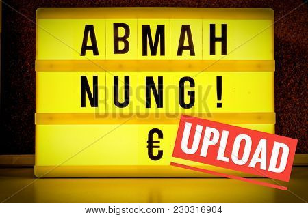 Luminous Sign With The Words Abmahnung In English Written Warning And A Euro Sign To Symbolize A War