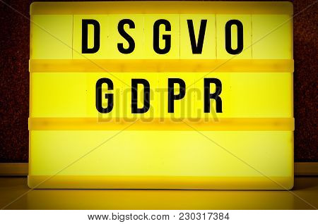 Illuminated Board With The Inscription Dsgvo And Gdpr ( Datenschutzgrundverordnung ) Yellow In Engli