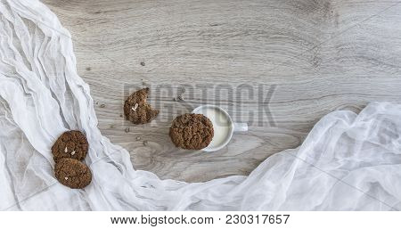 On A Wooden Table On A White Napkin Lie Oatmeal Cookies Sunflower Seeds Thaw A Glass Of Milk Crumbs