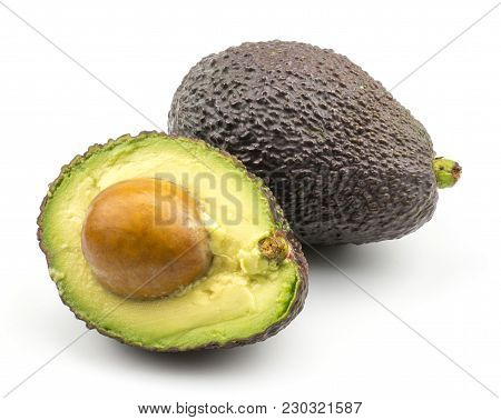 One Avocado And A Half With A Seed Isolated On White Background Ripe Green Brown Alligator Pear