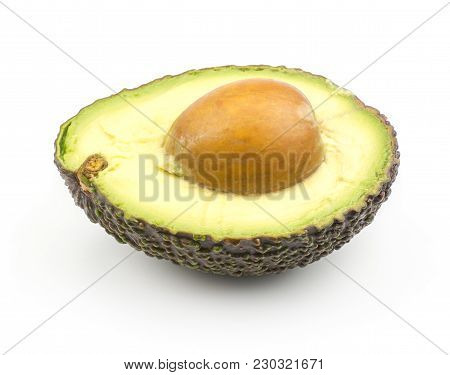 One Avocado Half With A Seed Inside Isolated On White Background Ripe Green Brown Alligator Pear