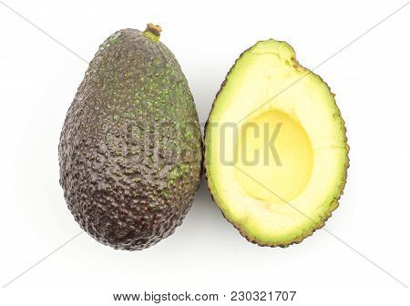 One Avocado And One Section Half Top View Isolated On White Background Ripe Green Brown Alligator Pe
