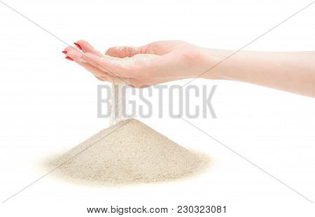 Sand Running Through Female's Hand On Heap. Isolated On White. Time Running Out Concept.