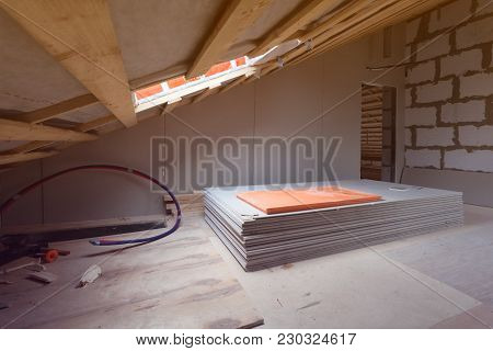 Interior Of Room Apartment With New Windows And Materials - Pieces Of Drywall- During On The Renovat
