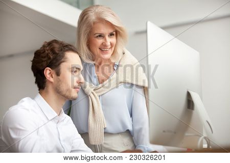 Aged Female Mentor Boss Smiling Looking At Computer Screen Happy For Achievement And Good Online Wor