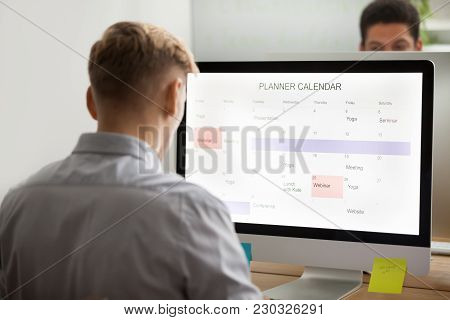 Businessman Planning His Day Making Event Schedule On Computer Planner Application In Office, Man Us
