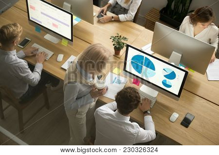 Corporate Employees Group Working On Desktop Pc Computers And Talking In Modern Office Together, Com
