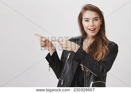 We Should Go In That Direction Together. Confident Attractive Modern Woman In Leather Jacket, Pointi