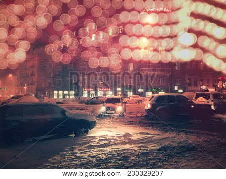 Kiev - Ukraine - January 2018: The Lights Of Shops And Gleaming Bokeh Reflexes, Snow, Auto, Bad Weat