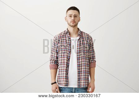 Guy Do Not Believe You. Portrait Of Attractive Slender Unshaved Man In Trendy Eyewear Standing In St