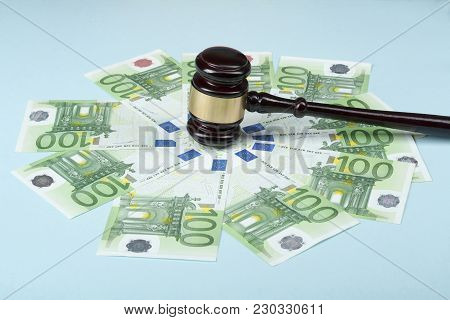 Law Concept. Judges Gavel And Money On Wooden Table. Concept On Corruption In Society.