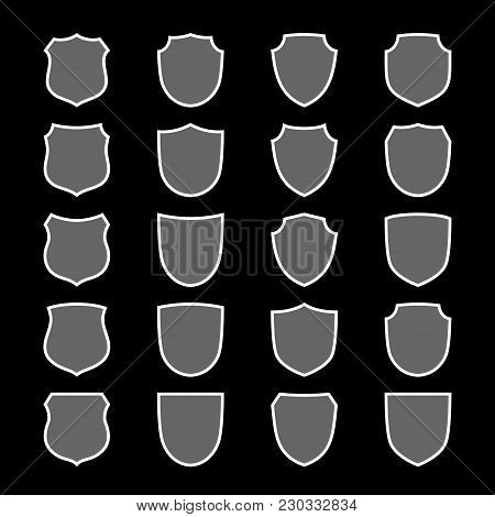 Shield Shape Icons Set. Gray Label Sign, Isolated On Black. Symbol Of Protection, Arms, Coat Honor,