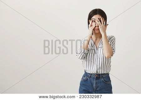 Is It Gone, I Am Scared. Shocked Attractive Stylish Woman With Dark Hair, Covering Eyes While Peekin