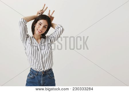 Let Me Be Your Bunny. Portrait Of Cute Stylish Adult Woman In Striped Blouse And Jeans With Trendy J