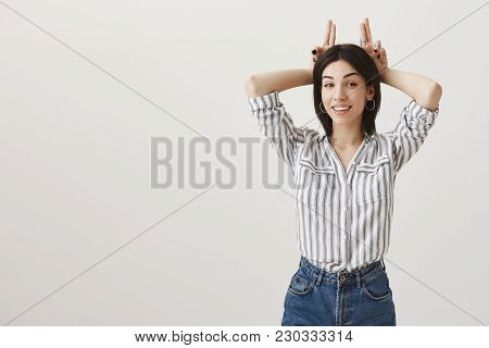 Girl Is All Ears To Hear Your New Excuses. Fashionable Feminine Caucasian Woman With Dark Hair Smili