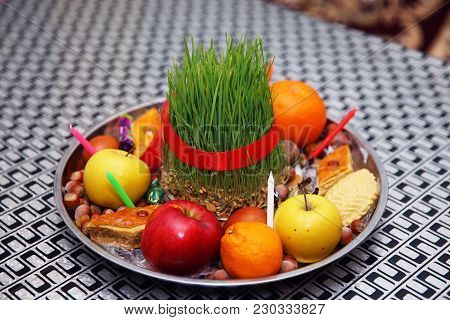 Semeni On Vintage Plate Decorated With Red Cord On National Style Table Cloth . Apple, Candle, Nuts