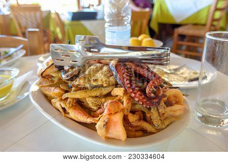 Seafood, Grilled Octopus, Fish And Prawns Served In Traditional Greek Tavern. Crete Island. Greece.