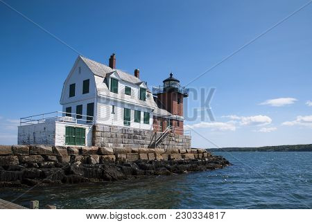Rockland Breakwter Lighthouse With Its Wooden Building And Brick Tower, Sits On The End Of A Breakwa