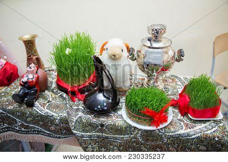 Connected With A Red Ribbon Green Semeni . Samovar. Sheep Puppet